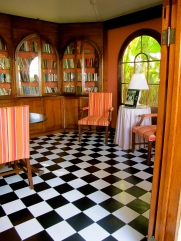 Arched book shelves echo the architecture amidst cheerful stripes