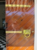 Colonial mahogany and brass appear throughout
