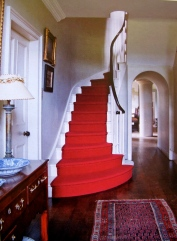 the gracious arches and warm wood enlivened by bold red