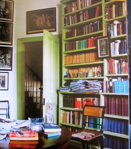 a wall of books in pea green invitation and space to write