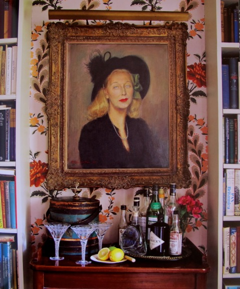 a mother's portrait presiding over evening drinks