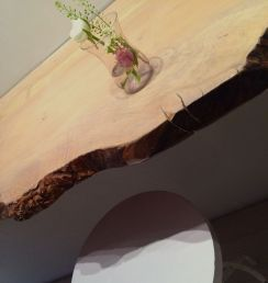 raw wood meets slick stools and THAT polished plaster