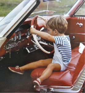 JFK junior at the wheel.